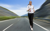 Woman running fast on the road