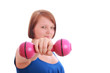 Pretty teenage girl holding a dumbbell