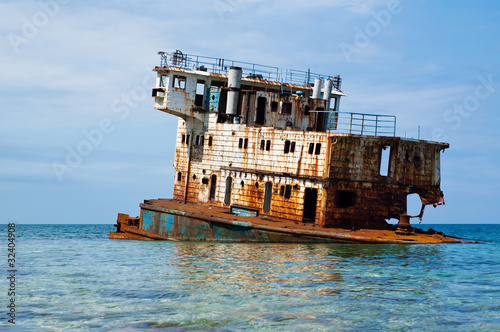 Rusty sunken ship