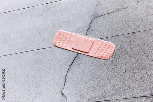 Plaster on a broken wall, symbolic