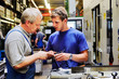 Leinwanddruck Bild - skilled workers controlling a workpiece