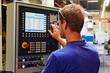 Leinwandbild Motiv skilled worker controlling a digitally programmed machine tool