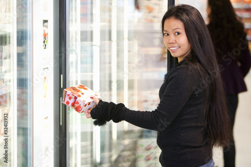 Woman Buying Yogurt