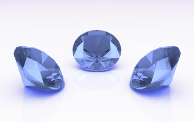 Trio of light blue round topaz stones