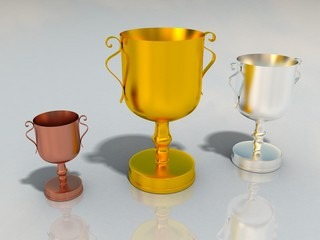 gold silver and bronze cups for winners