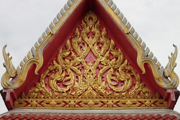 Thai art stucco carving and painting on gable of temple