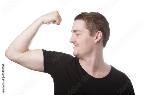 Young man flexing his biceps