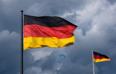 German flags in front of dark clouds