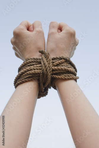 Tied with rope hands