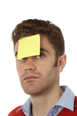 man with post it on his forehead