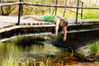 Girl Playing On Bridge