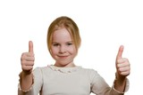 portrait of  girl giving thumbs up isolated on white