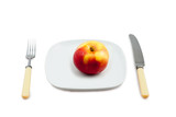Knife, plug and plate with an apple