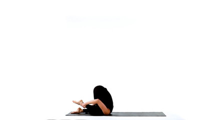 young woman make yoga wheel on ruuber mat