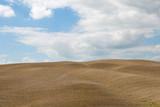 terreno appena arato pronto per la semina in Toscana poster
