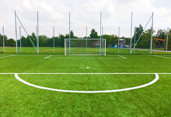 Football ground with goal gates