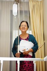 Asian ill old woman portrait in hospital ward