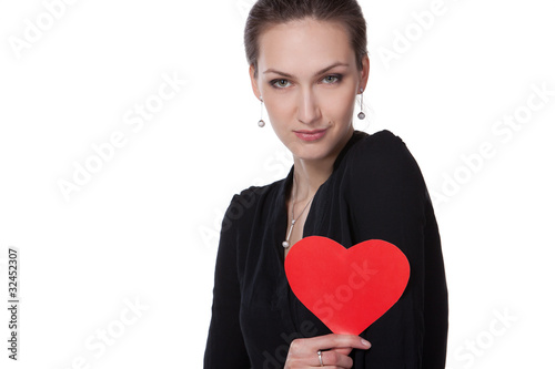 Portrait of young female holding heart shape