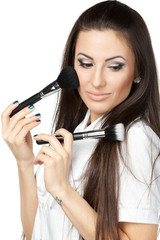 Young businesswoman applying mineral powder