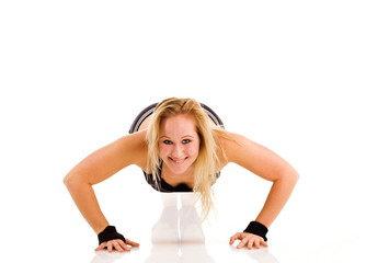 Young attractive Caucasian fitness woman doing gymnastics
