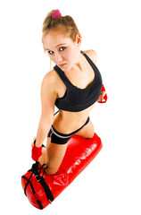 Attractive Caucasian girl with a boxing bag