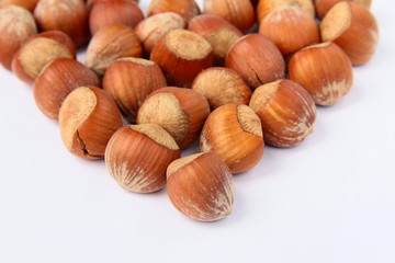 hazelnuts lined with a heart on a white background