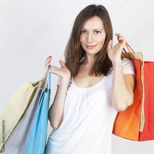 Woman shopping on white background