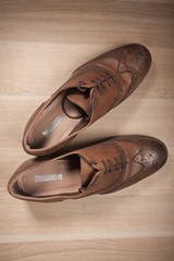 Top view of classical shoes on wood