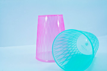 pink and blue plastic glass on white isolate