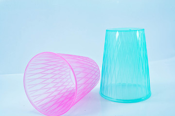 pink and blue plastic glass on white isolated
