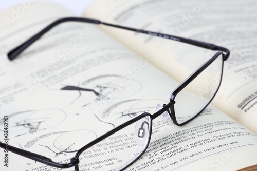 Eyeglass and Old Book