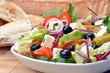 Leinwandbild Motiv Deftiger gemischer mediterraner Salat