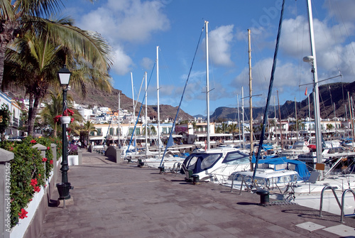 Puerto de Mogan Marina with mountain background and blue sky