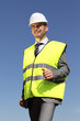 young businessman with hardhat and blue sky