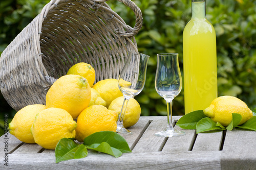 Basket with lemons and limoncello