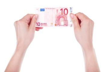 Twenty Euro banknote in female hands