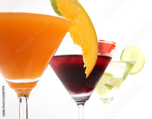 Tropical Martini drinks with fruits on white background