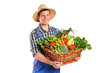 Smiling farmer holding a basket of vegetables
