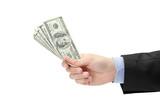 Hand holding US dollars