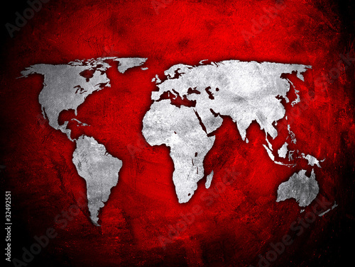 world map on red concrete wall © Eky Chan