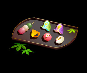 Japanese sweets wagashi on plate isolated over black