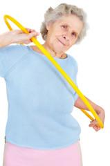 old woman doing gymnastic with hula-hoop
