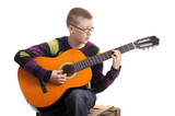 boy playing the accoustic guitar
