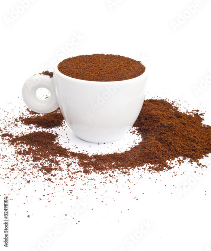 Cup of coffee with spilled coffee