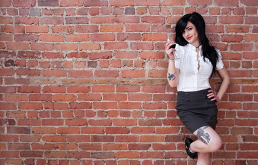 Tattooed girl with a glass of red wine
