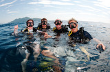 group of friends on surface before dive poster