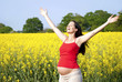 Pregnant woman joyful outside