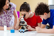 Family using microscope at home