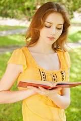 Long-haired girl reads book