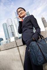 Businesswoman, skyscraper background